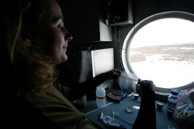 Kathryn Bywaters  (27) working in the lab on The FMARS (Flashline Mars Arctic Research Station)...Mars flashline Mars arctic (FMARS)..On Devon Island in the high Canadian Arctic a group of sciences from the USA &amp; Canada is gathering for four month to search watt human being can do on mars planet..The four month mission will be the first time that a simulated Mars mission has ever been conducted for such a long duration..The crow of volunteers includes some biologist geologist and other nether scientist researches...They chose Devon Island in Canada because it simulated the acclaim on the planet Mars, for getting the filling of being on Mars and to challenge the research and to make it close as they can to the conditions on the planet they wear spies suit and live isolated in the laboratory for four month..The man person that ran the project is Dr Robert Zabrin that believe that this project can lied to find ways to search for life on Mars and maybe to fined a way that human being will be able to live on the planet...This project is privet projects that cooperate with several universities around the world...