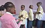 Refugee children, whose parents fled what is today South Sudan, prepare in their apartment for a day in school in Cairo, Egypt. They attend classes provided by St. Andrew's Refugee Services, and supported by Church World Service.