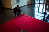 Houston, Texas<br /> October 2, 2011<br /> <br /> Straightens out the rug at the stadium entrance, President of the Houston Texans, Jamey Rootes is responsible for all business functions of the club. <br /> <br /> The Houston Texans vs Pittsburgh Steelers at the Reliant Stadium. The Texans win 17 to 10.