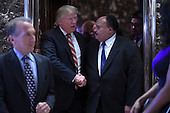 President-Elect Donald J. Trump (2nd from left)  shakes hands with Martin Luther King III as they exit the elevators in the lobby of the Trump Tower in New York, NY, on January 16, 2017.<br /> Credit: Anthony Behar / Pool via CNP