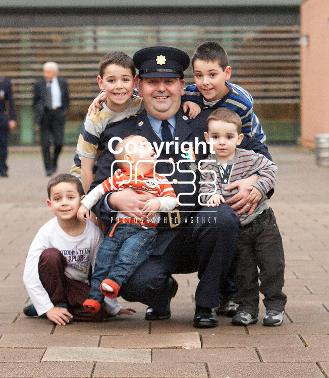 Father and Sons Garda Brian Dromey from Ratoath Co.Meath pictured wit his Sons Sean, Paul, Conor, Gerard & David after he received his Scott Medal for Bravery at Templemore Garda College. Pictured Credit Brian Gavin Press 22