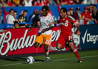 01 July 2010:  Houston Dynamo forward Joseph Ngwenya #33 and Toronto FC midfielder Nick LaBrocca #21 in action during a game between the Houston Dynamo and the Toronto FC at BMO Field in Toronto..Final score was 1-1....