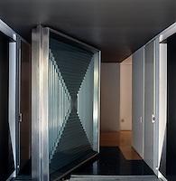 The dramatic pivoting steel entrance door to the Casa En El Aire