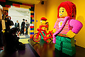 June 14, 2012, Tokyo, Japan - Journalists take photos of a Lego man and woman during a press preview event at the LEGOLAND Discovery Center Tokyo. The LEGOLAND Disovery Center contains over 3 million LEGO bricks in-house, a 4D movie theater, iconic city land marks of Tokyo all made of LEGO, and a interactive laser ride. The discovery center will open to the general public on June 15, 2012. (Photo by Christopher Jue/AFLO)