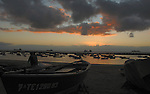 Silhouettes of fishermen boats and ships, Teresitas beach early morning, San Andreas, Santa Cruz, Tenerife, Canary Islands. Sand originally imported from the Sahara.