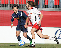 Drew Yates #12 of the University of Maryland runs past Servando Carrasco #10 of the University of California during an NCAA championship round of sixteen soccer match at Ludwig Field, on November 29, 2008 in College Park, Maryland. The match was won by Maryland 2-1