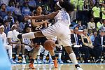19 November 2014: Oklahoma State's Brittney Martin (22) bounces a pass under North Carolina's Xylina McDaniel (34). The University of North Carolina Tar Heels hosted the Oklahoma State University Cowgirls at Carmichael Arena in Chapel Hill, North Carolina in a 2014-15 NCAA Division I Women's Basketball game. UNC won the game 79-77.