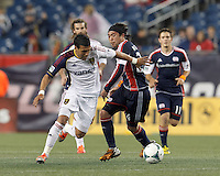 Real Salt Lake midfielder Javier Morales (11) on the attack as New England Revolution midfielder Lee Nguyen (24) defends. In a Major League Soccer (MLS) match, Real Salt Lake (white)defeated the New England Revolution (blue), 2-1, at Gillette Stadium on May 8, 2013.