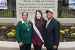 Ohio University President, Roderick McDavis, and Ohio University First Lady, Deborah McDavis, pose with Kat Satreed, a member of Ohio University's Homecoming Court, at the College Gateway on October 8, 2016.
