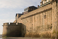 The Ramparts, 15th century military architecture, parapet resting on corbelled machicolations and crowning both towers and walls, constructed mostly during the Hundred Years War, Le Mont Saint Michel, 13th century, thanks to a donation by the king of France, Philip Augustus, Manche, Basse Normandie, France. Picture by Manuel Cohen