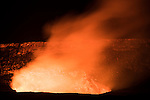 Hawai'i Volcanoes National Park, Big Island of Hawaii, Hawaii; the glow of the lava lake, several hundred feet beneath the rim of the Halemaʻumaʻu crater on Kīlauea volcano,  is visible after sunset