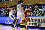 17 December 2015: Liberty's Jaymee Fisher-Davis (right) passes the ball around Duke's Oderah Chidom (22) and Kyra Lambert (15). The Duke University Blue Devils hosted the Liberty University Flames at Cameron Indoor Stadium in Durham, North Carolina in a 2015-16 NCAA Division I Women's Basketball game. Duke won the game 79-41.