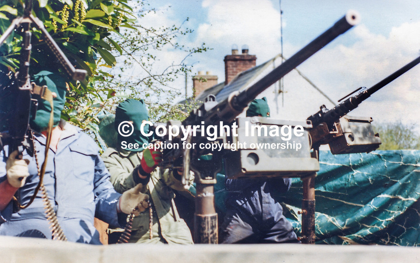 This republican movement press release photograph claims to be of a Provisional IRA border unit on manoeuvres in Co Fermanagh, N Ireland, February 1977.  The volunteers are seen using Browning M2 50mm machine guns. 197702130024f<br />