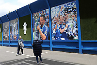 A Chelsea fan takes a picture of the large John Terry photos on display on the surrounding wall outside the ground during Chelsea vs Sunderland AFC, Premier League Football at Stamford Bridge on 21st May 2017