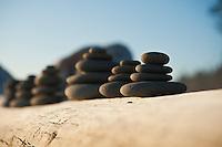 Rock piles on log at beach