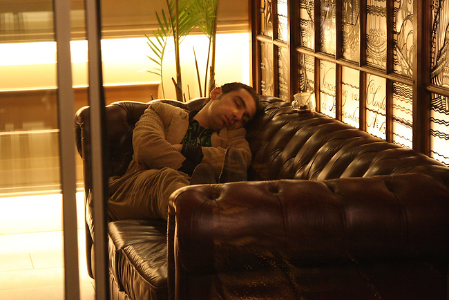 A man sleeps in a hotel lobby in Amsterdam, Netherlands. March 16, 2008.