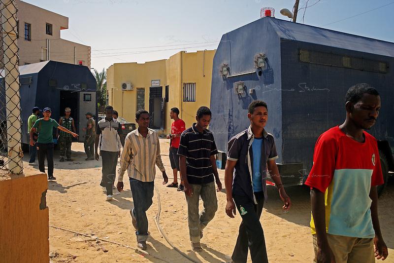 Tripoli, Libya, August 27, 2011.Rebel troops round up suspected Khaddafi mercenaries in a east Tripoli prison; some still carry their mercenary ID's on them..