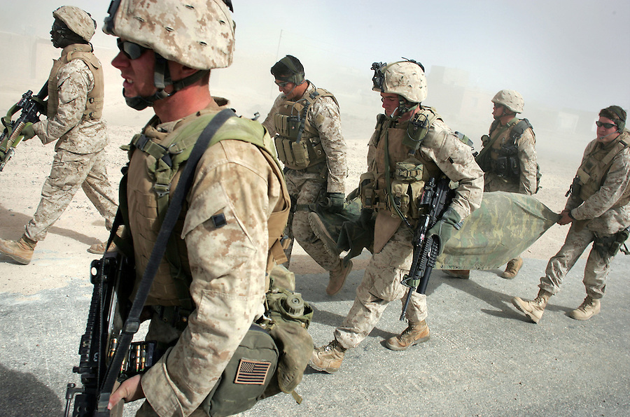 Members of the 3rd Battalion 6th Marines' scout-sniper platoon carry a wounded member of the battalion's Kilo Co. to a waiting Army medevac helicopter after the Marine and two comrades were wounded by a hand grenade while carrying out a raid on the home of a suspected insurgent in Sa'dah, Iraq on the Syrian-Iraqi border on Wed. Nov. 2, 2005.