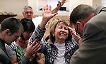 Teresa Napier prays as her preacher at the Hyden Church of God blesses her with annointed oil on Wednesday, Oct. 9, 2013. Mrs. Napier recently discovered that her kidneys weren't functioning normally. <br /> Photo by Coty Giannelli