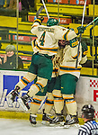 29 December 2013:  University of Vermont Catamount Defenseman Nick Bruneteau, a Senior from Omaha, NB, joins in the celebration of Jake Fallon's tournament-winning goal in the final game against the Canisius College Golden Griffins at Gutterson Fieldhouse in Burlington, Vermont. The Catamounts defeated the Golden Griffins 6-2 to capture the 2013 Sheraton/TD Bank Catamount Cup NCAA Hockey Tournament for the second straight year. Mandatory Credit: Ed Wolfstein Photo *** RAW (NEF) Image File Available ***