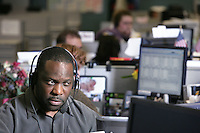 Donald Clark works in customer service for the Comcast Cable Call Center in Fife, Washington. Clark uses a headset rather than a telephone receiver to prevent next strain that comes from cradling the phone between the ear the shoulder.