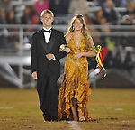 Freshman maid Madaline Ball is escorted by Wes Brown at Lafayette High vs. Lewisburg in Homecoming football action in Oxford, Miss. on Friday, September 30, 2011.