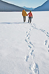 Bowron Lakes, winter, tracks Hikers walk on the ice of Bowron Lake, British Columbia, in search of animal tracks in the fresh snow