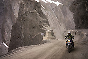 A motorcyclist rides on the Leh-Srinagar highway in Ladakh region of Kashmir, India.