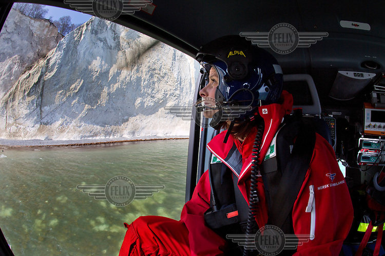 Landing drill on a beach by some high cliffs. <br /> <br /> Denmarks first  air ambulance serivce, operated by Norwegian Air Ambulance. The crew is pilot Jan Nielsen, HEMS paramedic Lars Greve-Wilms and doctor Charlotte Barfod. <br /> <br /> The crew operate an Airbus EC-135 out of the Ringsted base, one of three bases in Denmark.