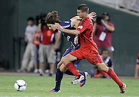 WASHINGTON, DC - July 28, 2012:  Perry Kitchen (23) of DC United challenges Adrien Rabiot (31) of PSG (Paris Saint-Germain) in an international friendly match at RFK Stadium in Washington DC on July 28. The game ended in a 1-1 tie.