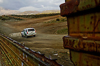 Border patrol vehicles patrol the length of the fence that separates Tecate, Mexico from the United States...Tecate, Baja California, Mexico on February 8, 2013.  (Javier Manzano / For The Washington Post).