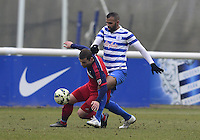 Sandro of QPR tackles Shaun Maloney of Chicago Fire