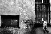 Wroclaw 23.05.2006 Poland<br /> The worst and the most dangerous district in Wroclaw ( Poland ) , called by people &quot;The Bermuda Triangle&quot;. There are walls bearing an inscription &quot;Who will enter here, will not exit alive&quot; Many families there are pathological and live in extreme poverty. Children have no place for any games so they loaf around on this wasted district and disseminate a juvenile delinquency. Many of them become sexually active though they are only 10-12 years old<br /> (Photo by Adam Lach / Napo Images)<br /> <br /> Najbardziej nabezpieczna dzielnica we Wroclawiu zwana przez ludzi Trojkatem Bermudzkim. Sa tam sciany opatrzone napisem &quot; Kto tu wejdzie, nigdy nie wyjdzie stad zywy&quot; Mieszka tam wiele rodzin patologicznych i zyja w wielkiej nedzy. Dzieci wlocza sie po ulicach nie majac miejsc na zabawe i szerza przestepczosc wsrod nieletnich. Wiele z dzieci uprawia seks choc maja zaledwie 10-12 lat<br /> (Fot Adam Lach / Napo Images)