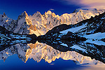 Les Aiguilles and Lac Blanc<br /> Savoy Alps, France<br /> One of the most spectacular views in the European Alps is that across Lac Blanc to the Chamonix Needles. Lit at sunset, the white glaciers soften to pink and the stark granite spires are gilded.