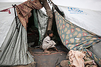 Thursday 09 July, 2015: A displaced child from the heavy fighting and bombardments in Haradh bordertown is seen in Darawan, a temporary settlement in the outskirts of Sana'a, the capital city of Yemen. (Photo/Narciso Contreras)