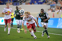 Stephen Keel (22) of the New York Red Bulls and Darlington Nagbe (6) of the Portland Timbers chase down a ball during a Major League Soccer (MLS) match at Red Bull Arena in Harrison, NJ, on September 24, 2011.