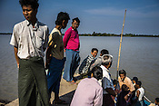Villagers gather at the main jetty of in Kwin Sekhan Village to catch the big boat going to Bogale town in Pyapon district of Myanmar.