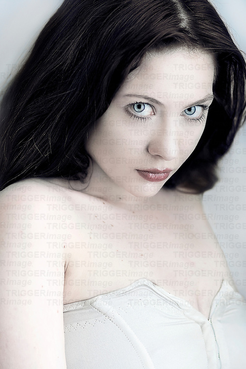Close up of a girl with black hair and pale skin.