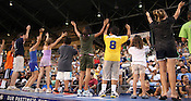 Children preform the YMCA on top of the dugout duringGame 3 of the annual Collegiate Friendship Series between Team USA and Japan on Tuesday, July 5, 2011. Photo by Al Drago.