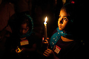 Hazuri Kaur Dhillon and Nivaaz Kaur Dhillon attend the candle light vigil at the Sikh Gurudwara of North Carolina in Durham to honor the victims of the Oak Creek shooting on Wednesday August 8th 2012.