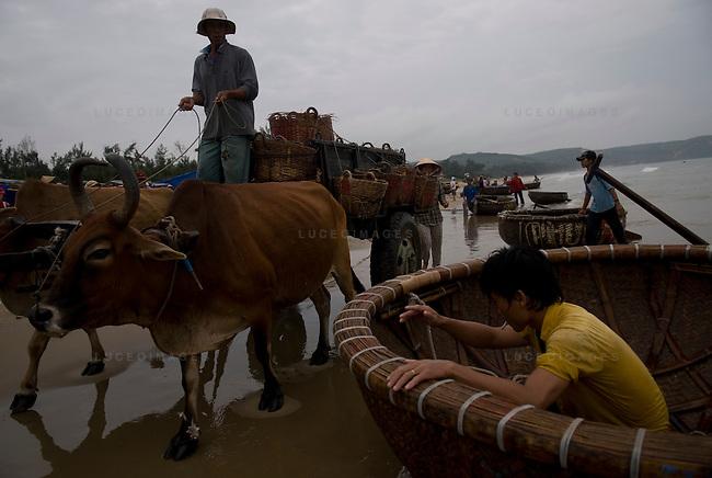 Fishermen work on the beach in Mui Ne, Vietnam.