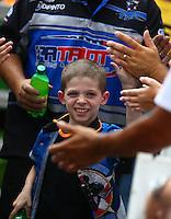 Jun 21, 2015; Bristol, TN, USA; NHRA funny car driver Terry Haddock and his son during the Thunder Valley Nationals at Bristol Dragway. Mandatory Credit: Mark J. Rebilas-