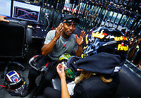 May 14, 2016; Commerce, GA, USA; NHRA top fuel driver Antron Brown (left) talks to teammate Leah Pritchett in the teams car hauler in the pits during qualifying for the Southern Nationals at Atlanta Dragway. Mandatory Credit: Mark J. Rebilas-USA TODAY Sports