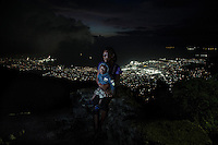 Lanier Lovely, 18, who was displaced by the earthquake in Haiti in 2010, pictured with her son, Lovinsky, in Port-au-Prince, Haiti.<br /> <br /> I was living with my mum and then she had a problem because she couldn't pay the rent so she moved to her friend's house. She took my little brother but there was no room for me so I went to somebody elses house who was living nearby. I was 16 when I was living with them, they didn't even send me to school, I was there to do all their work in the house. <br /> <br /> When the earthquake happened I was in the kitchen preparing a meal for everybody and I felt that the house was shaking, then I bent on my knee and prayed to the lord. I was so scared of the shaking because it was very hard. The house collapsed and I was hurt, blocks fell on my knee. At the very beginning I didn't realise that I was bleeding, I walked just to help the others that were trapped and then my leg was so sore I fell down. I was crying because I didn't know were my mum was. After the earthquake we slept in the streets. It was very difficult because I was in agony bleeding, there were dead bodies and also people crying. 2 days after we went back to the house to get some clothes and important things and then we went straight to a camp in Delmas 33 named St Louis de Gonzague. <br /> <br /> It was so strange because everybody was searching for their relatives but no-one was searching for me. After 5 days I saw my mum, we went back to the house to get laundry, that's when mum found me. I was very very happy because I felt that she was dead. <br /> <br /> I got raped by a man. I was in the camp for 6 months before it happened. I used to see him in the camp he pretended that he loved me and I told him that I'm not living with my family so it's not possible to get a relationship so then that night he raped me. It was about 4am, I was staying by myself because everyone was in the countryside for a funeral, he had a knife, he threatened me, I tried to defend myself and then he raped me. I tried to scream but