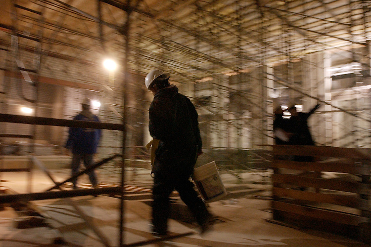 A worker walks through the auditorium on the site of the Capitol Visitor Center.