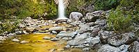 Dorothy Falls near Hokitika with golden light of sunset reflecting in water, West Coast, South Westland, New Zealand, NZ