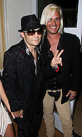 BEVERLY HILLS, CA, USA - MARCH 28: Corey Feldman, Daniel C. DiCriscio at the Versace Unveiling Of The 1st Pop Recording Artist Superhero - KUBA Ka's Performance Outfits. Designed by the legendary fashion hosuse - Donatella Versace. For the Benefit of the Face Forward Foundation (Plastic Surgery for Destroyed Faces from Violence). Pop entertainer TV personality KUBA Ka, together with VERSACE, unveiled Kuba Ka's new Versace images, for the First Pop Artist/Superhero of the World. He has become the inspiration of Donatella's newest and wildest creations and will celebrate the launch of his new power house conglomerate - KUBA Ka Empire Inc. in collaboration with the sensational fashion house - VERSACE on Friday, his birthday at a red carpet media and celebrity event at the luxurious Peninsula Hotel in Beverly Hills held at the Peninsula Hotel on March 28, 2014 in Beverly Hills, California, United States. (Photo by Xavier Collin/Celebrity Monitor)