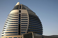 The Libyan funded Borj Al-Fateh Hotel in central Khartoum, Sudan, on Friday, Apr. 13, 2007. The Hotel, designed to represent a sail,  opened in November 2007 and is one of only two 5-star hotels in Khartoum..Khartoum is modeling itself as the Dubai of Africa and despite Western sanctions the city is booming. Away from the troubles and poverty that plaque the rest of Sudan, development in Khartoum is moving at an astonishing rate. Investment from the East, and in particular China, allowed the Sudanese economy to grow by 11% in 2007. This growth is driven largely by oil, with production rising from 63,000 barrels per day in 1999 to over 500,000 barrels today.