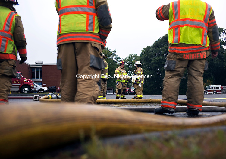 Wolcott, CT- 03 October 2015-100315CM07- ​Firefighters particulate in a training exercise at the Wolcott Elementary School on Saturday.  Departments from Wolcott, Bristol, Southington and Prospect participated in the event.     Christopher Massa Republican-American
