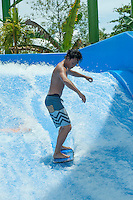 Yujiro gettig the hang of it on his first attempt on a static wave.<br /> Kuta, Bali